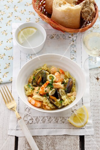 Seafood risotto and a bread basket