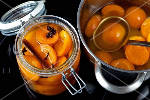 Apricot compote in a jar and in a pot