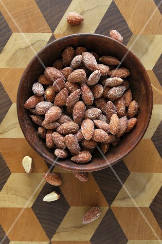 Roasted almonds in a wooden bowl