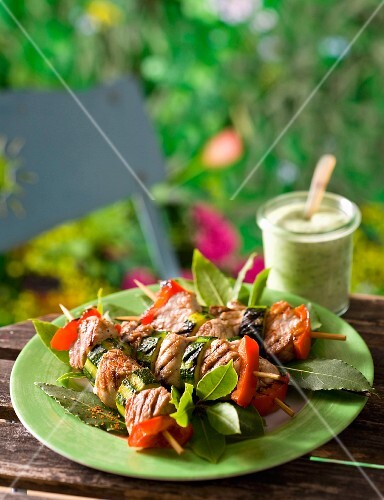 Beef skewers with peppers and courgettes on bay leaves