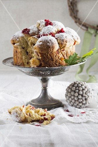 Stollen with cranberries on a cake stand