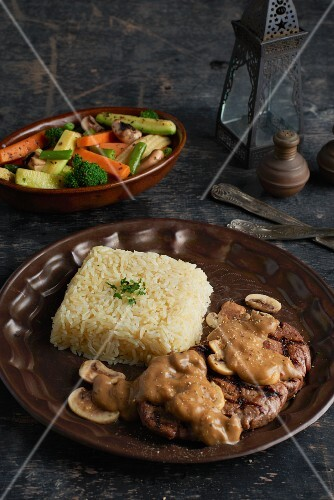 Fillet steak with mushroom sauce and rice