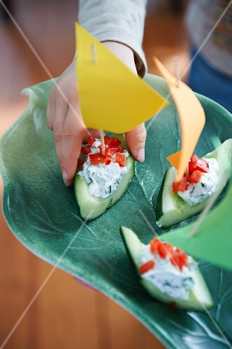 Cucumber boats with herb cream cheese and tomatoes
