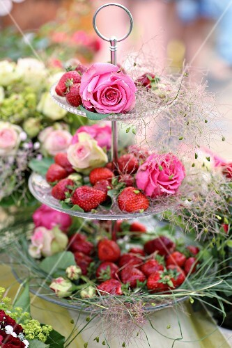 Strawberries and roses on cake stand