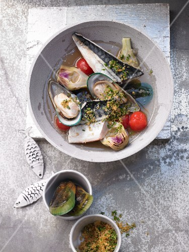 Mackerel fillets with green shell mussels, artichoke hearts in a spicy broth and herb crumbs