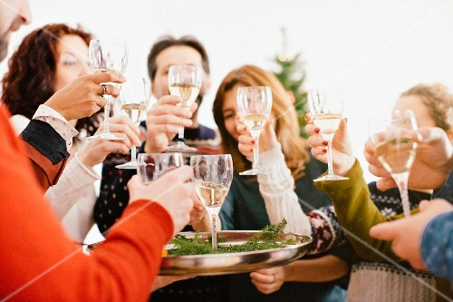A family raising a toast with champagne at a Christmas party