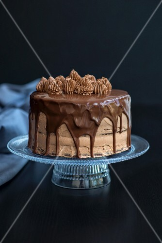 Chocolate cake with a chocolate spread filling and a chocolate fudge glaze