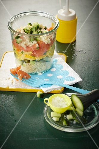 Layered couscous dish with smoked salmon, egg and cucumber