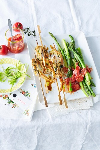 Satay skewers with strawberry chutney and asparagus