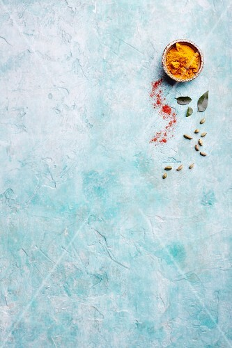 Spices on a blue surface