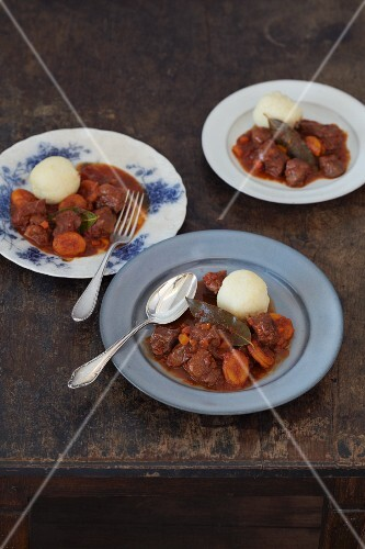 Wild boar goulash with dried apricots and potato dumplings