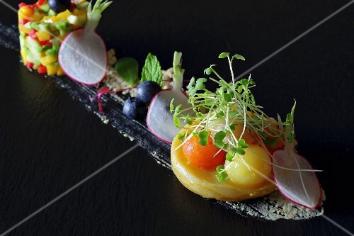 Artichokes with melon balls and cress, radishes and blueberries