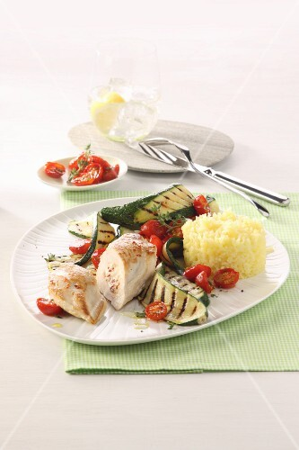Stuffed turkey breast with courgette, tomatoes and rice timbale
