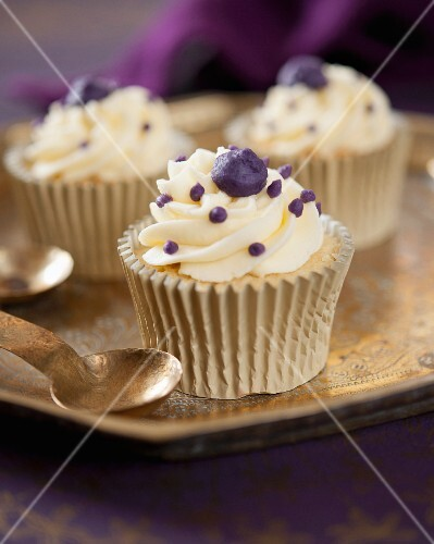 Vanilla cupcakes with blackcurrant cream