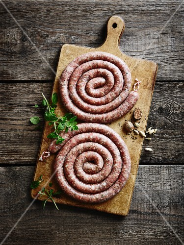Sausage spirals on a chopping board
