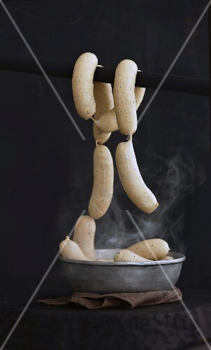 White sausages being steamed