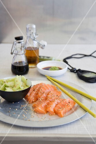 Sashimi with cucumber salad, soy sauce and wasabi