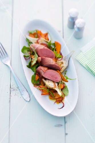 Saddle of lamb on a pumpkin salad