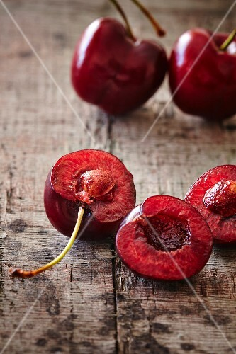 Fresh Spanish cherries on a wooden board