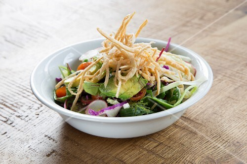 Salad with guacamole and fried tortilla strips (Mexico)