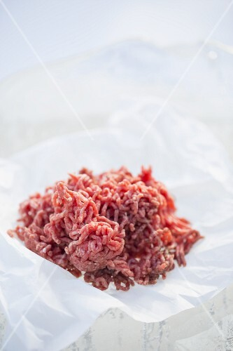 Fresh minced meat on a piece of paper