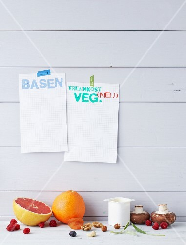 Food against a wooden wall with diet notes