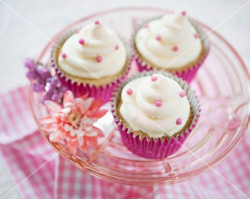 Vanilla cupcakes with pink sugar pearls