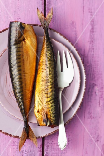 Smoked mackerel on a plate with a fork