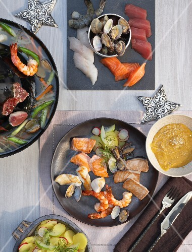 Cooking at the table: fish and seafood cooked in a tatar fondue