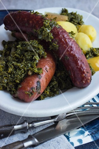 Pinkel (smoked sausage made from bacon, groats and spices) with kale and potatoes