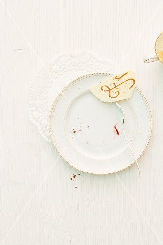 Crumbs and the remains of a Christmas cake on a plate
