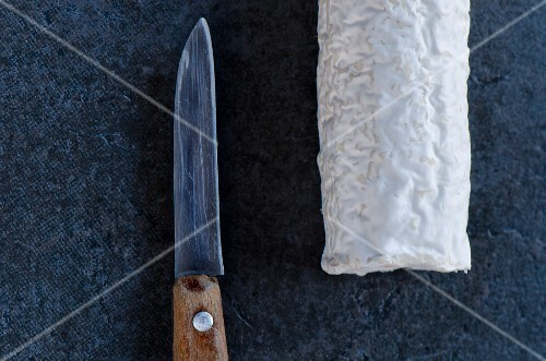 French goat's cheese with a knife (seen from above)