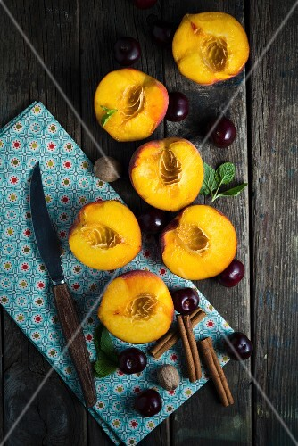 An arrangement of nectarines, cherries and spices