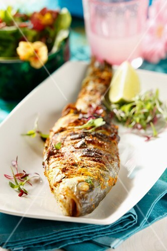 Roasted sea bass with spices and limes