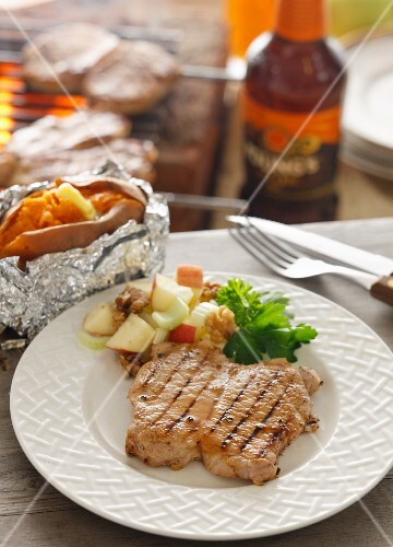 Grilled pork steak with sweet potatoes, and apple salad with walnuts