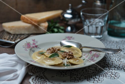Spinach and ricotta ravioli with sage butter and walnuts