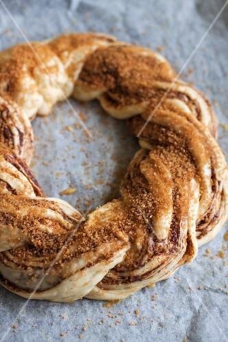 An unbaked cinnamon bread wreath