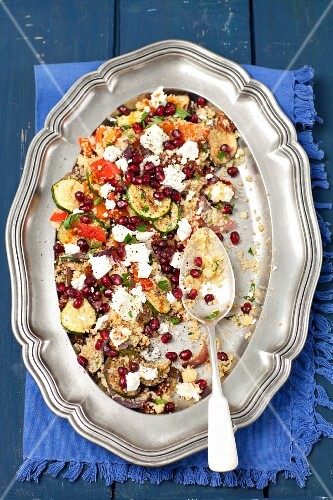 Couscous salad with grilled vegetables (courgette, aubergine, pepper, onion), feta cheese and pomegranate seeds