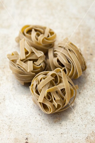 Spinach tagliatelle on a grey surface