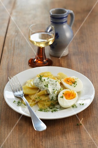 Braised potatoes with egg and herb sauce