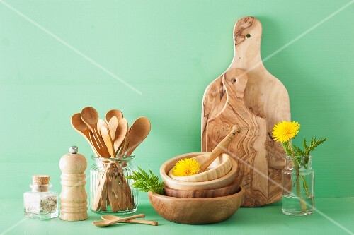 Wooden kitchenware and dandelion flowers