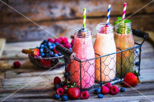 Three smoothies and fresh berries