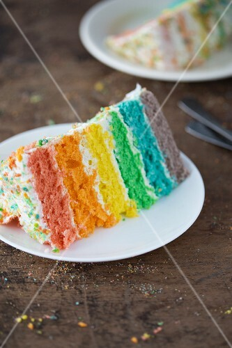 A slice of a rainbow layer cake