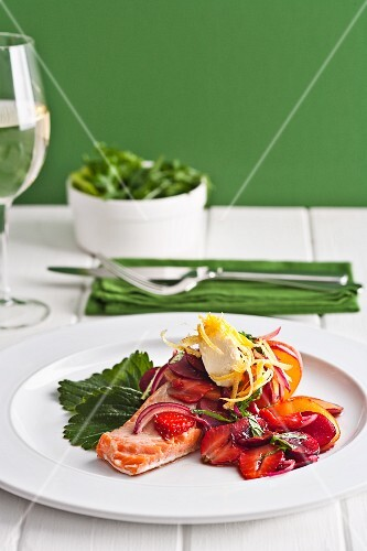 Poached salmon with summer fruits and onions