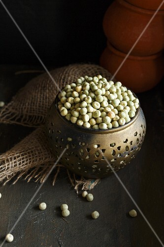 Dried green peas in a metal bowl