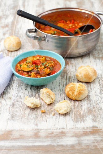 Vegetable goulash with courgettes, pepper and aubergines served with bread rolls