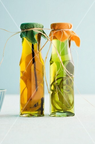 Bottles of homemade orange oil and herb oil