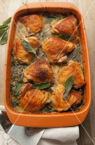 Roasted chicken thighs in a creamy kale sauce