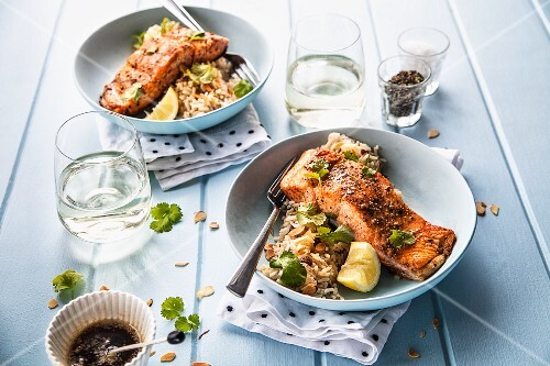 Oven-roasted salmon fillets on almond rice
