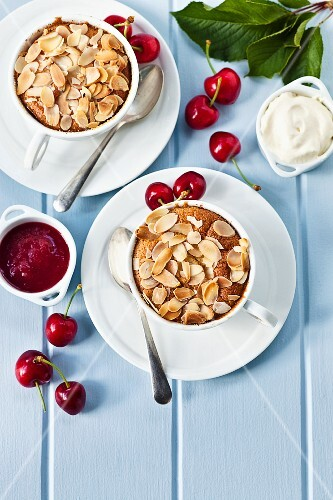 Cherry clafoutis in cups with cherry sauce (seen from above)